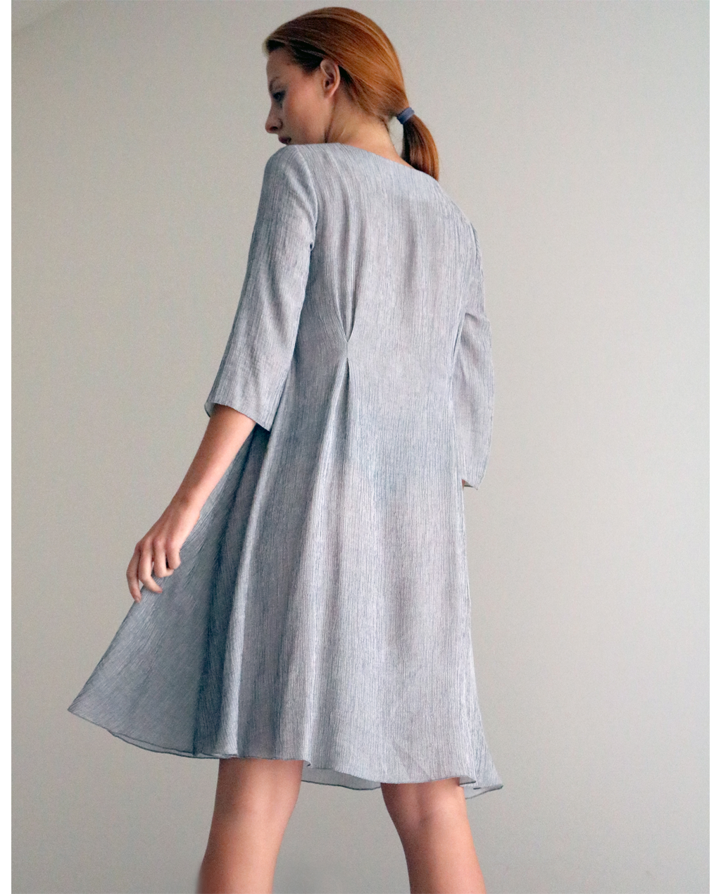 Adelaine Mini dress from Adelaine series short in A line silhouette, light and breezy featuring 3/4 sleeves and darts at the back for better fit