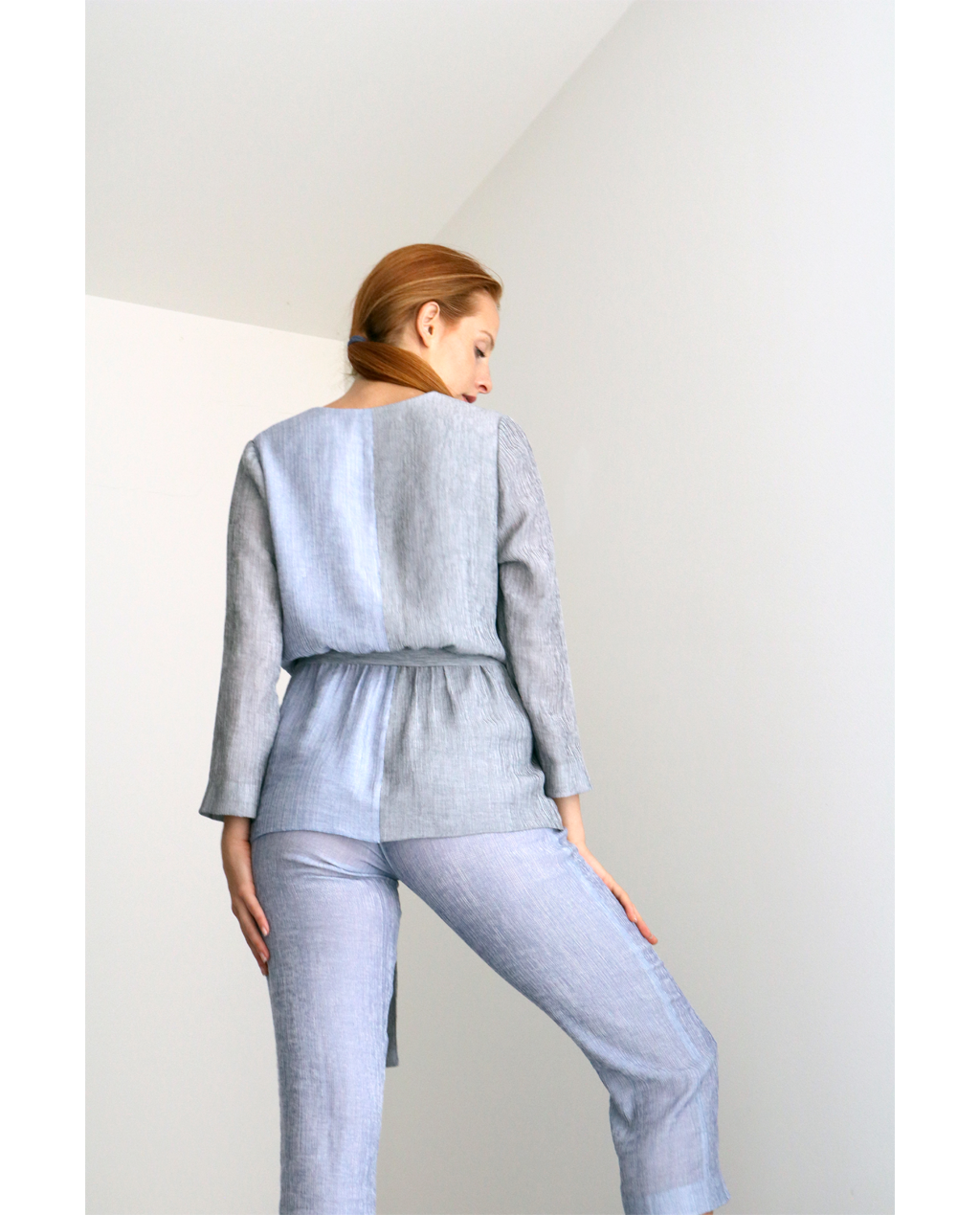 Juno wrap around shirt is perfect top or overcoat in summer weather. Double coloured in light grey and blue featuring gathered waist with gives more adjustment to your body