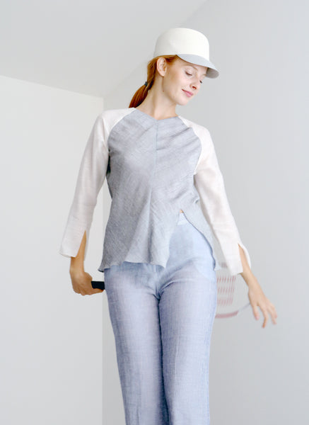 Natalie top with raglan sleeves and sculptured body in Light Grey colour and fabric is perfect match for your sporty days in the city. Match it up with sneakers to complete the look or choose or Marlene pants.