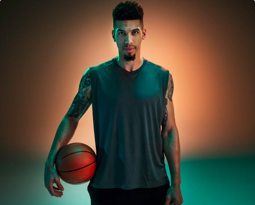 Danny Green Basketball player holding basketball looking at camera - wide crop