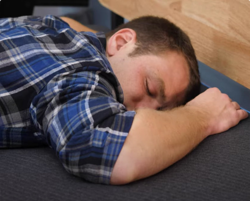 man sleeping face down on Eight Sleep Pod