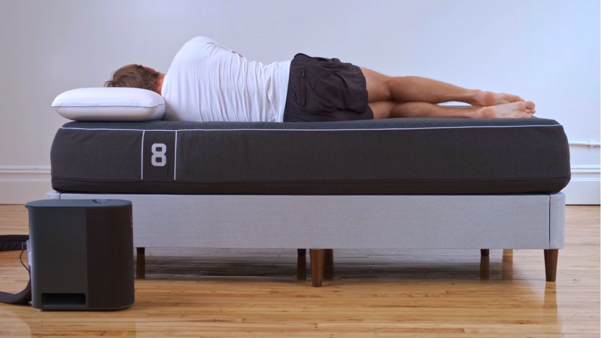 Man sleeping on Pod Pro - view of spinal alignment from the back