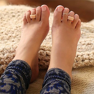 What are the symptoms of hammertoe?