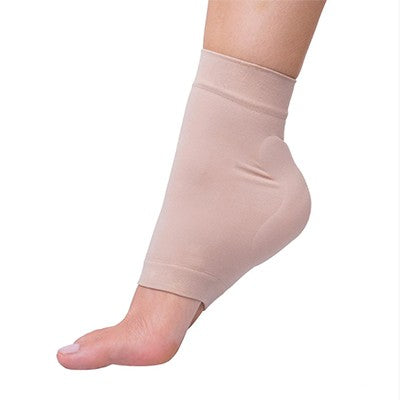 How does a heel pad help to relieve pain?