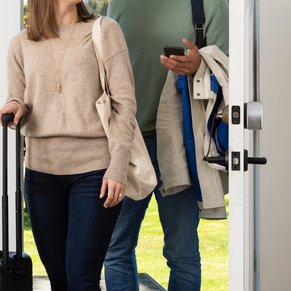 Couple Walking Into House Using Guest Keys