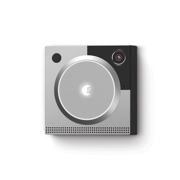 A silver doorbell security camera on the grey and white background