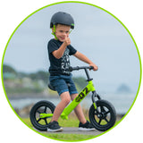 Young Boy on Balance Bike Green Madd