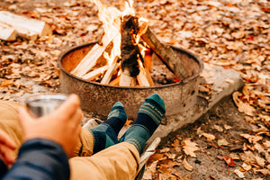 A man on trail in hiking boots wearing darn tough decade stripe men's hiking socks
