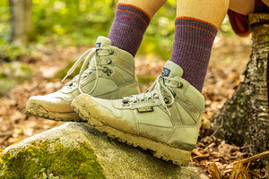 woman at hiking shelter wearing women's boot socks
