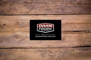 The Darn Tough gift card (socks are the perfect last minute gift idea) on a wooden table