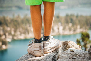 kids' hiking socks on a child standing on a rock, great merino wool socks for kids