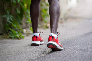 group of runners standing on a trail wearing running socks of various heights and colors