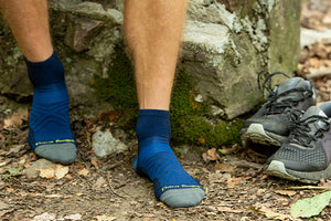 Hiker wearing men's 1/4 socks, the perfect quarter crew height