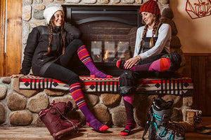 Skier putting on winter snow socks for women