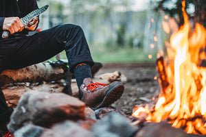 Hiker wearing darn tough men's hiking socks and tying hiking boot on. Look no further for the best socks for men