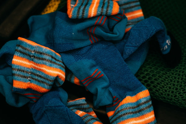 Pile of darn tough socks ready to go in the laundry