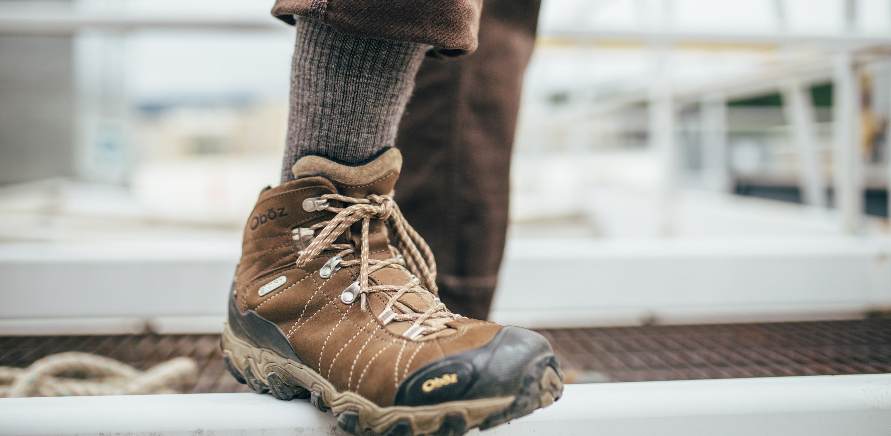 Foot wearing darn tough socks for work in brown work boots