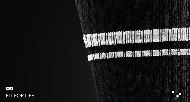 "image of a black sock with two white stripes that are on the leg. the pic is narrowed to that part and the words ""fit for life"" are on the image"