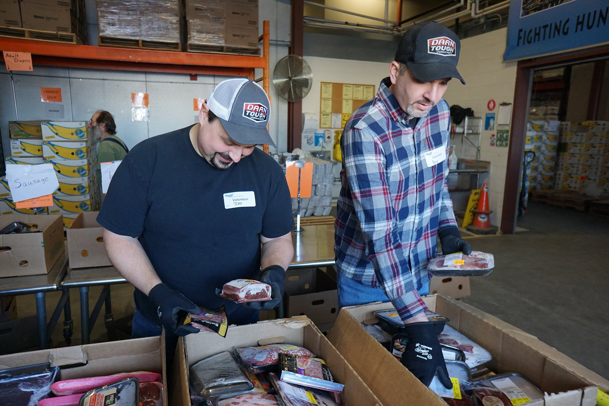 two men volunteering at food bank