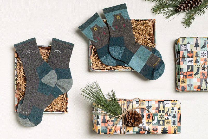 Best selling socks for her laid out with some great holiday wrapping paper