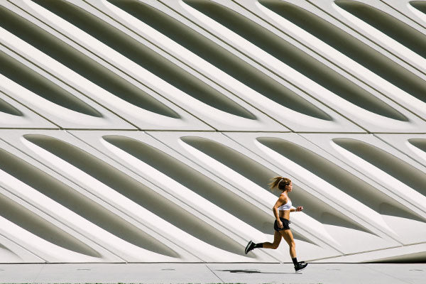 Woman running in hot weather in merino wool socks, the best socks for hot weather