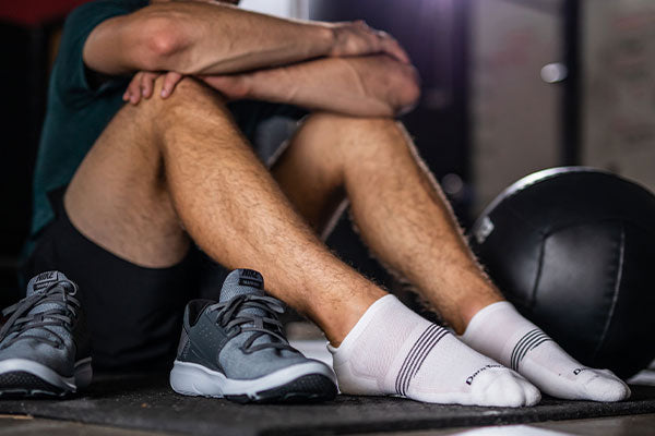 person at gym working out in darn tough merino wool socks, great for sweaty feet