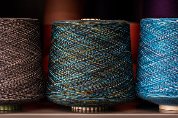 Super fine merino wool yarns or threads on a cone (it makes really soft socks)
