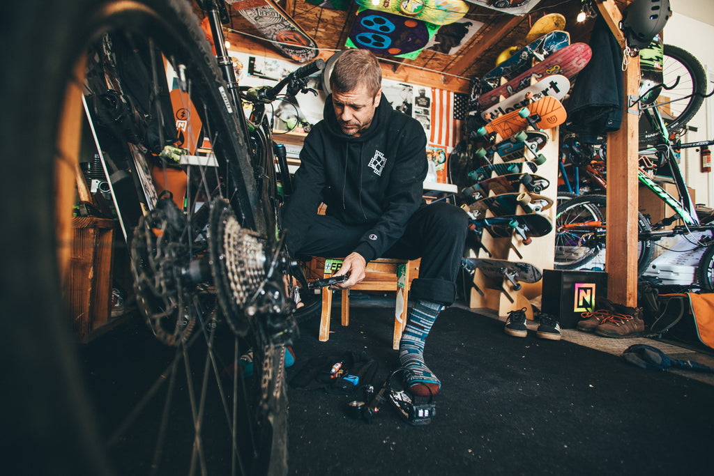 Jeremy Jones sits in his garage working on bikes.
