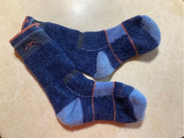 Turn merino wool socks inside out before placing in the washing machine