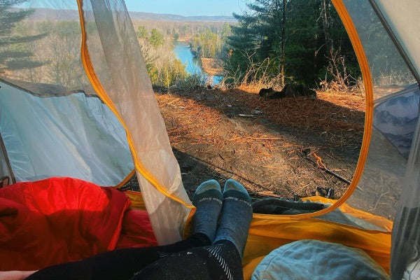 Sleeping in socks may be a good idea if you're camping in the spring, winter, or fall