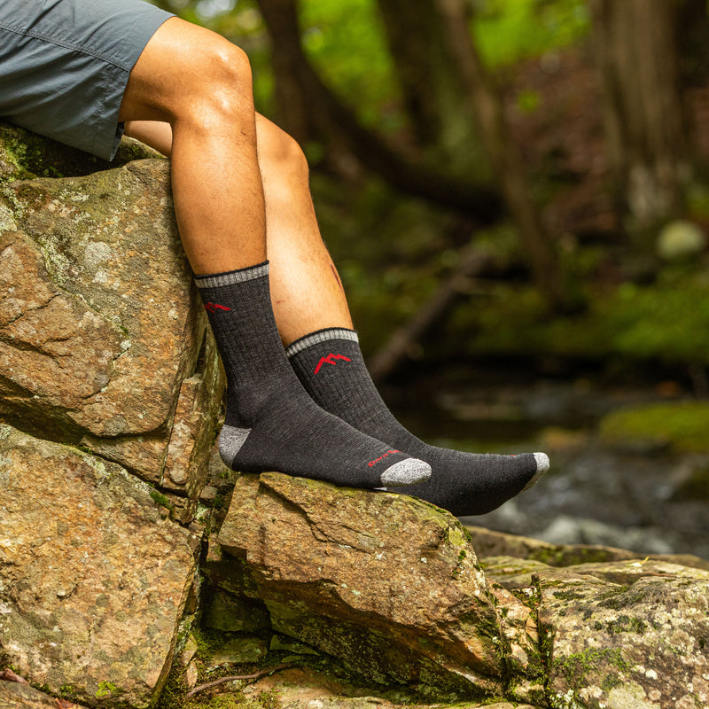 Man outside wearing Hiker Micro Crew Cushion Black Hiking Socks
