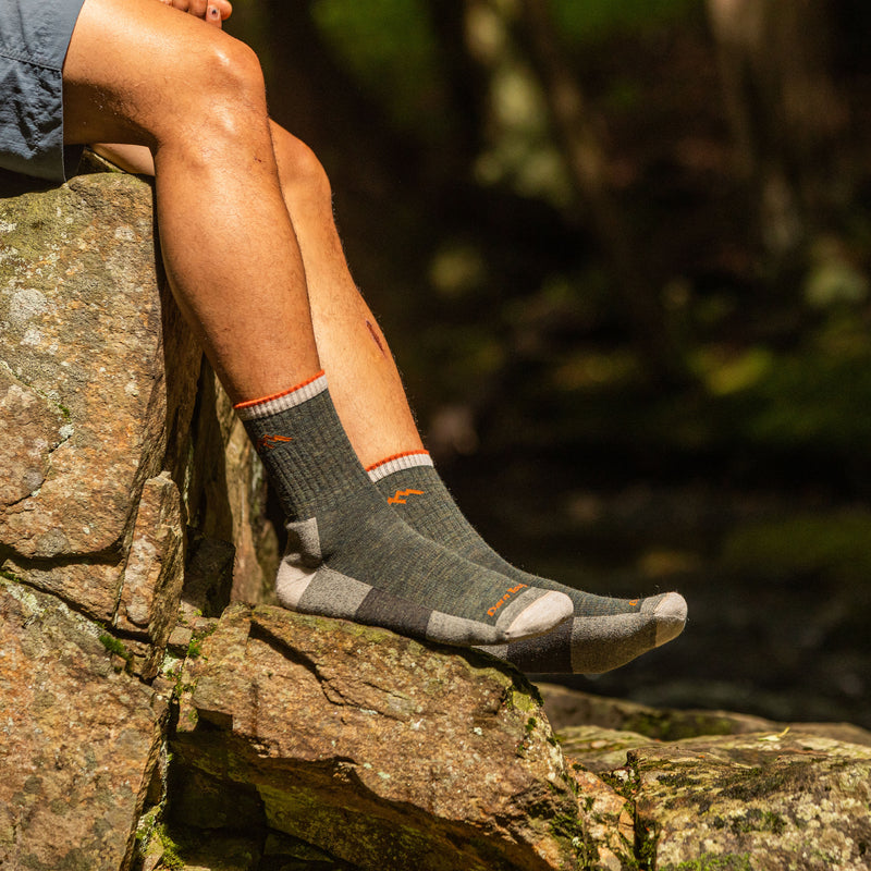 Man outside wearing Hiker Micro Crew Cushion Olive Hiking Sock