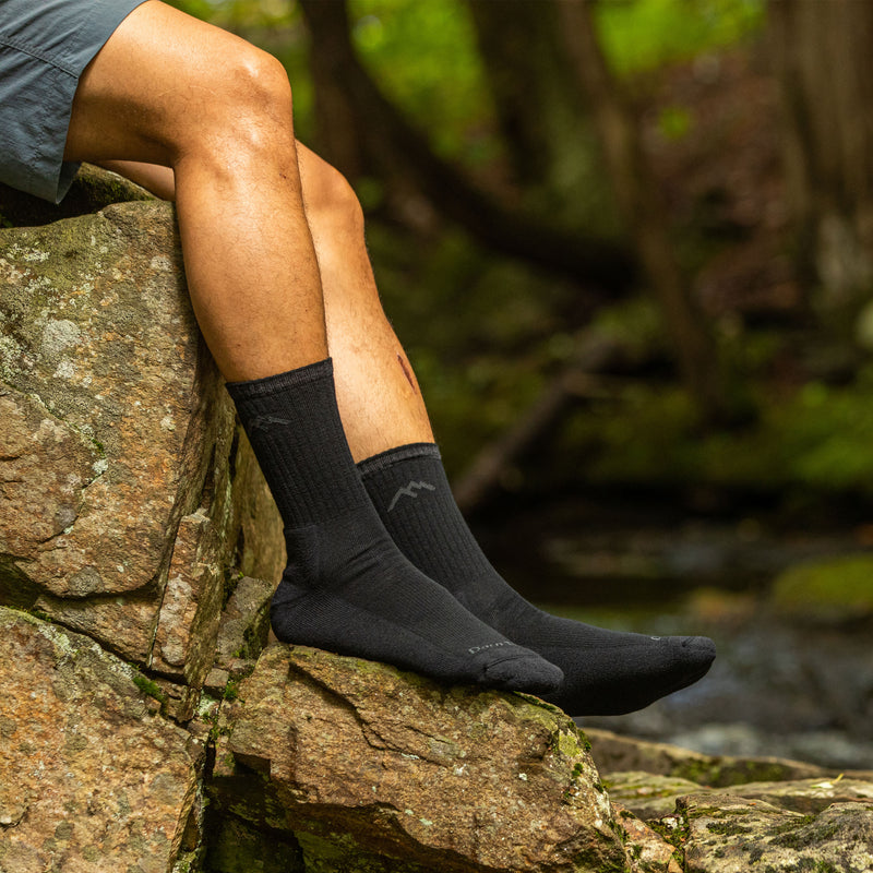 Man outside wearing Hiker Micro Crew Cushion Onyx Hiking Sock