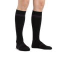 Image of a woman's legs on a white background wearing Women's Element Over the Calf Lightweight Athletic socks in Black