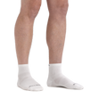 Man standing barefoot wearing Run Quarter Ultra-Lightweight Running Socks in White