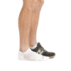 Profile of male legs facing right, front foot wearing Run No Show Tab Ultralightweight Running Socks in White and the back foot also wearing an athletic sneaker