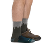 Man standing facing to the right wearing Number 2 Micro Crew Midweight Hiking Socks in green, with back foot also wearing a hiking shoe