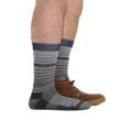 Profile of male legs facing right wearing Frequency Crew Lightweight Lifestyle Socks in Gray with back foot also in a casual shoe