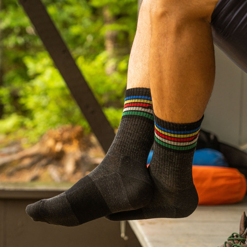 Close up lifestyle image of a male legs hanging off a hammock, wearing Kelso Micro Crew Lightweight Hiking Sock in Charcoal, Lifestyle Image