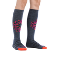 Image of a woman's legs on a white background wearing Women's Sacred Over the Calf Midweight Ski & Snowboard Socks in Denim