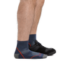 Profile of male legs facing right wearing Light Hiker Quarter Lightweight Hiking Socks in Denim with back foot in a sneaker