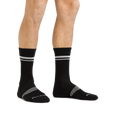 Man standing barefoot wearing Element Crew Lightweight Athletic Socks in Black