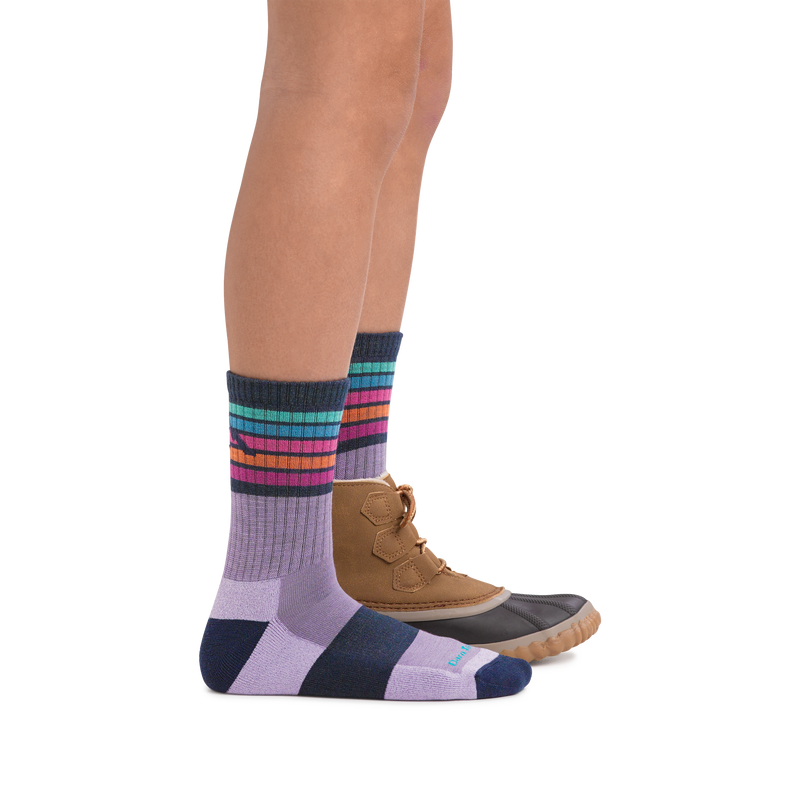 Profile image of kid legs facing to the right wearing Kids Kelso Micro Crew Lightweight Hiking Socks in Lavender with foot in rear also wearing a boot