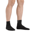 Man standing barefoot wearing Hiker Quarter Midweight Hiking Socks in Black
