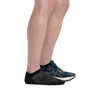 Profile of male legs facing to the right wearing Coolmax Run No Show Tab Ultra-Lightweight Running Sock in Black with back foot also in a running shoe