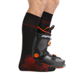 Man standing facing to the right wearing Thermolite® RFL Over-the-Calf Ultra-Lightweight Ski & Snowboard Sock in Black with back foot also in a ski boot