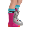 Profile image of kid legs facing to the right on a white background wearing Kids Mountain Top Over the Calf Midweight Ski 7 Snowboard Sock in Pink with rear foot also in a ski boot