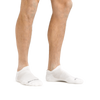 Man standing barefoot wearing Run No Show Tab Ultralightweight Running Socks in White