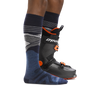 Profile of male legs facing right wearing Liftline Over the Calf Lightweight Ski & Snowboard Socks in Denim with back foot in a ski boot