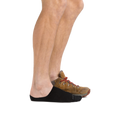 Profile of male legs facing right wearing Topless Solid No Show Hidden Lightweight Lifestyle Sock in Black with a casual shoe on the back foot